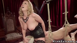Busty blonde mistress whips her slaves