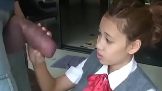 Asian schoolgirl opens wide to suck huge cock