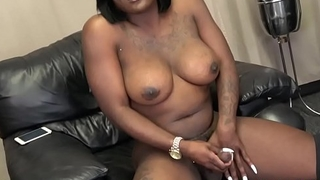 Nubian ts beauty stroking her fat cock