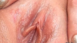 Sweet cutie is gaping shrewd cunt in closeup and having orgasm