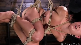 Slave in suspension gets feet torment